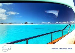 Reflection in yacht window of turquoise water and uninhabited island