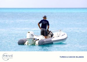 Azimut's first mate in tender ferrying supplies to and from secluded beach and yacht