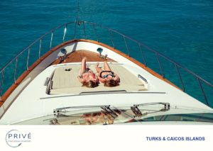Two young ladies sunbathing on the bow of a luxury motor yacht