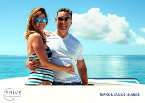 Married couple posing on bow of luxury motor yacht