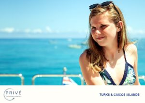 young lady looking over the bow of a luxury motor yacht
