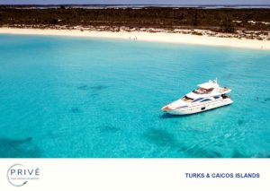 Arial view of luxury motor yacht in pristine turquoise waters