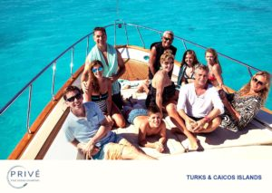 Family posing on the bow of a luxury motor yacht