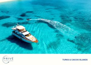 Arial view of luxury motor yacht anchored off the shores of Providenciales