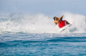 Woman shredding up the water in a hair-pin turn on a jet ski