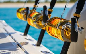 Array of deep sea fishing equipment locked into rod holds of Hydrasports 5300 Sport Yacht