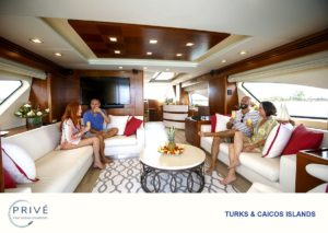 Four guests sharing mimosas in the grand salon on boar Prive' Fine Ocean Charters