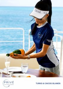 Attractive female crew member pouring champagne on the fly deck of Azimut Luxury Sport Yacht