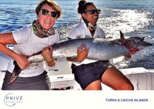 Captain Trish and Prive' guest struggling to hold up giant Wahoo