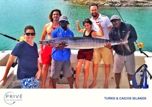 Family and guests of Prive' Fine Ocean Charters posing with the days respectable catch