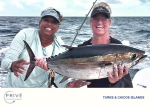 Captain Trish and Prive' guest posing with fresh catch tuna