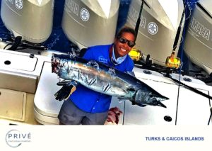 Prive' boat captain posing with half-eaten Wahoo showing signs of brutal struggle between angler and shard