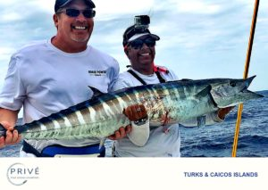 Captain Trish and Prive' guest posing with huge Wahoo