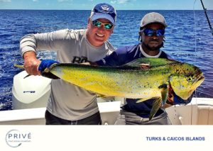 Guest and Privé boat captain posing with Dorado catch