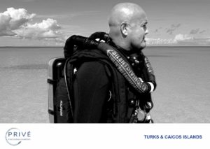 Profile black and white photo of diver equipped with re-breather gear