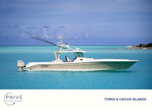 Hydrasports 53' motor boat anchored in calm turquoise blue water