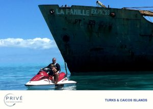 Father and son on jet ski touring the La Famille wreck in the Turks and Caicos Banks