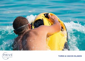 Man riding a yellow Seabob F7 on the water's surface