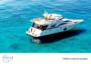 Arial view of luxury motor yacht with crew on the stern transom