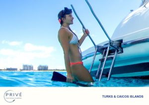Attractive young woman exiting the water from the stern ladder of an Azimut Luxury Sports Yacht