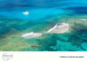 Azimut Luxury Motor Yacht aerial view just off the Turks and Caicos' barrier reef