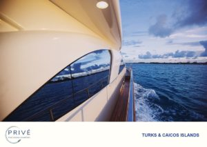 Looking down bulwark of Azimut 80 Sports Yacht with view of uninhabited islands mirrored in the window