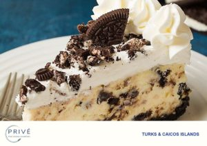 Big slice of cookies-n-cream cheesecake with cookie crumbles and whip cream frosting