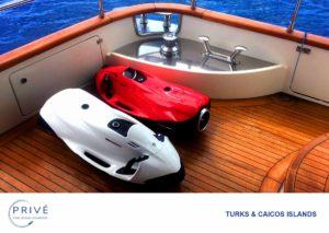 Red and white Seabob personal watercraft on the deck of luxury motor yacht