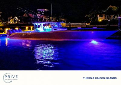 Hydrasport 53 motor boat at night with underwater lights on