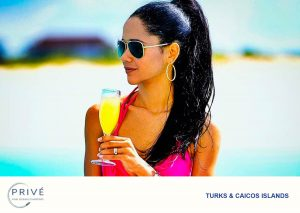 Attractive young woman, black hair pulled back in ponytail wearing Ray Ban sunglasses, sipping on a mimosa