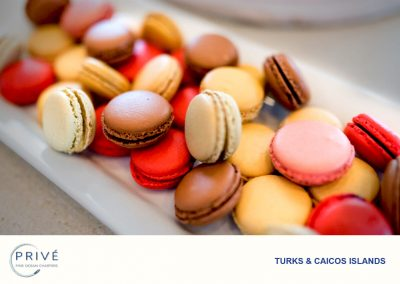 Assortment of colorful macaroons on a white ceramic serving tray