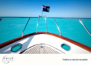 Turks and Caicos Island Flag blowing in the wind on the bow of Azimut Yacht