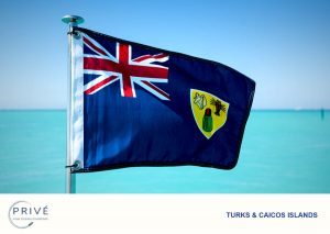 Turks and Caicos Islands Flag with ocean in the background