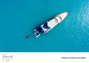 Drone ariel photo of yacht, jet ski and inflatable floating in a turquoise blue ocean
