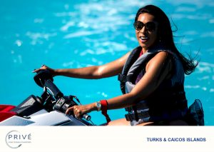 Attractive woman with sunglasses idling on jet ski