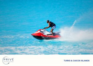 Man going all out on jet ski in standing position