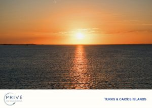 Warm hues saturate the skis while the sun sets into the ocean reflecting a the suns final beams