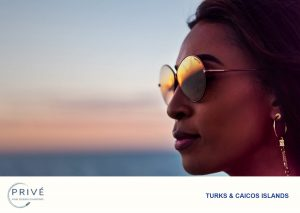 Close of up of attractive woman with sunset reflected in her sunglasses